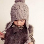 Cute Little Girl in an Earflap Hat